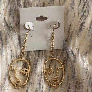 Cutout face earrings